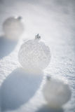 Silver Christmas balls on snow Royalty Free Stock Images
