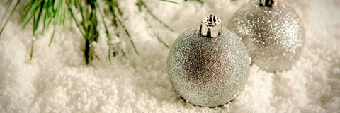 Silver Christmas balls in the snow. Silver Christmas balls in the white snow royalty free stock photo