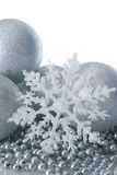 Silver christmas balls and snowflake. Silver christmas balls and white snowflake royalty free stock photography