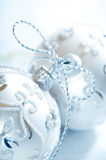 Silver christmas balls tied with silver string Stock Images