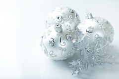 Silver christmas balls on white background. Three silver christmas balls on white background royalty free stock photography
