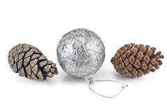 Silver christmas bauble with pine cones Royalty Free Stock Photos