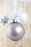Silver christmas bauble on ribbon. Christmas decoration - silver bauble on ribbon Royalty Free Stock Photo