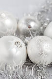 Silver christmas baubles. Silvery christmas decoration baubles on silver background Royalty Free Stock Photos