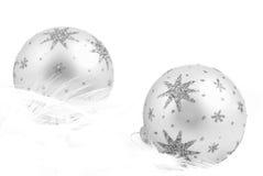 Silver christmas baubles Stock Photos
