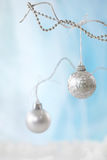 Silver christmas baubles Stock Images