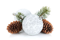 Silver christmas baubles and fir tree Stock Images