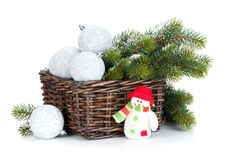 Silver christmas baubles and fir tree Stock Image
