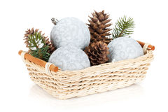 Silver christmas baubles and fir tree Royalty Free Stock Photo