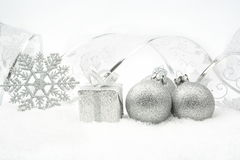 Silver christmas baubles,gifts,snowflake with silver ribbon on s Royalty Free Stock Image