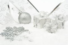 Silver christmas baubles,gifts,snowflake with silver ribbon on s Royalty Free Stock Photos