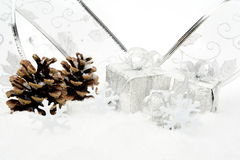 Silver christmas baubles,gifts,snowflake with silver ribbon on s Royalty Free Stock Photography