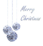 Silver Christmas baubles hanging from silver string Stock Photos