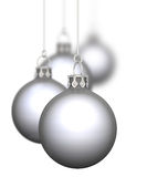 Silver Christmas baubles. Hung in row with white background Royalty Free Stock Photography