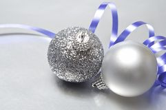 Silver Christmas Baubles and Mauve Ribbon Royalty Free Stock Photos