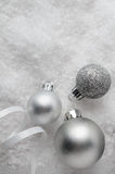Silver Christmas Baubles on Snow Royalty Free Stock Photography