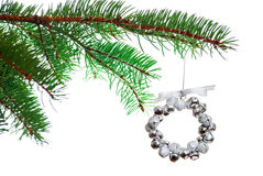 Silver Christmas bell wreath on a branch Royalty Free Stock Photo