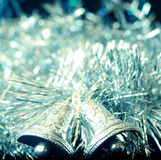 Silver christmas bells. On sparkling background Stock Photo