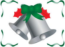 Silver Christmas Bells with Holly and Ribbons Royalty Free Stock Photos