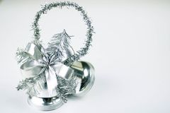 Silver christmas bells on a white background stock photo