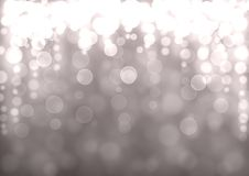 Silver Christmas bokeh background. Silver Christmas abstract bokeh glitter lights festive background. Gray beige circle bokeh texture. Space for text Royalty Free Stock Images