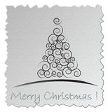 Silver Christmas card. White Christmas Tree isolated on a silver background Stock Photos