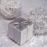 Silver christmas card. Decoration balls and gift box Stock Photo