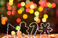 Silver Christmas Cookie cutters with colorful bokeh background stock image