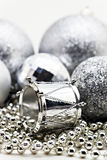 Silver Christmas decoration, balls, beads, bell close up isolate Stock Photography