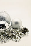 Silver Christmas decoration, balls, beads, bell close up isolate Royalty Free Stock Photos