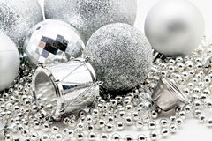 Silver Christmas decoration, balls, beads, bell close up isolate Royalty Free Stock Photography