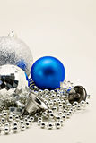 Silver Christmas decoration, balls, beads, bell close up isolate Stock Images