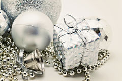 Silver Christmas decoration, balls, beads, bell close up isolate Stock Photos