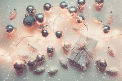 Silver Christmas decoration balls and gift on white. Top view. Xmas pattern stock images