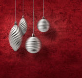Silver christmas decoration on red Stock Photo