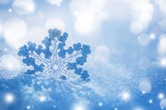 Silver Christmas decoration on snow Stock Image
