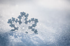 Silver Christmas decoration on snow. Silver Christmas decoration. Beautiful snowflake on real snow outdoors. Winter holidays concept Royalty Free Stock Photos