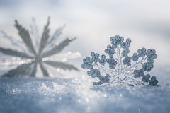 Silver Christmas decoration on snow. Silver Christmas decoration. Beautiful snowflake on real snow outdoors. Winter holidays concept Stock Images