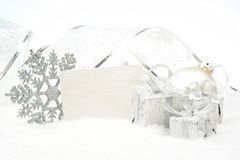 Silver christmas decoration on snow with wishes card Royalty Free Stock Image