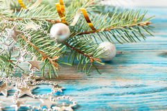 Silver Christmas decorations and fir branch Royalty Free Stock Photography