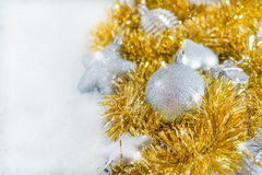 Silver Christmas decorations and golden tinsel Stock Images