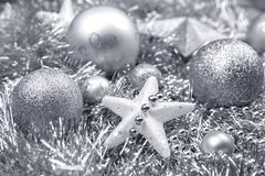 Silver Christmas Decorations on tinsel royalty free stock photo