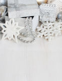 Silver Christmas decorations - snowflakes, baubles, garland and Royalty Free Stock Image