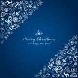 Silver Christmas elements in corner on blue background Royalty Free Stock Images