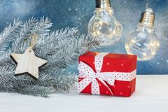 Silver christmas fir tree branch, decorations and gift boxes on Stock Photos