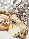 Silver Christmas gift with baubles decorations Royalty Free Stock Images
