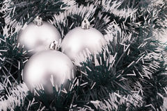 Silver Christmas gift with ornaments Royalty Free Stock Image