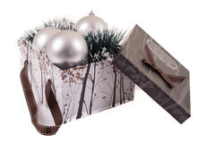 Silver Christmas gift with ornaments Stock Image