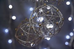 Silver Christmas Globes. Hanging over a background of blurred lights Stock Photography