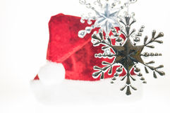 Silver Christmas hanging snowflake ornaments with Santa hat Royalty Free Stock Photography